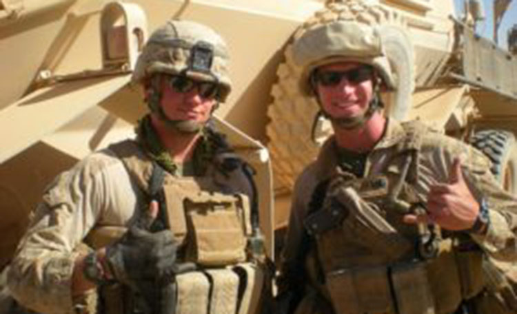 Chris Walsh and Military Partner with Tank