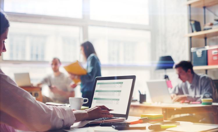 Employees Working in Open Office