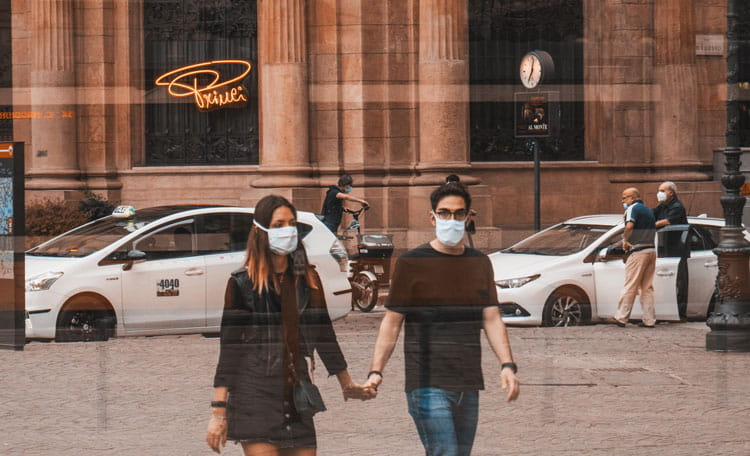 couple with face masks on Milan street