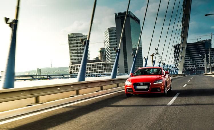 Most SNP bridge, Bratislava, Slovakia with red car