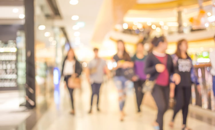 People walking in shopping centre blurred