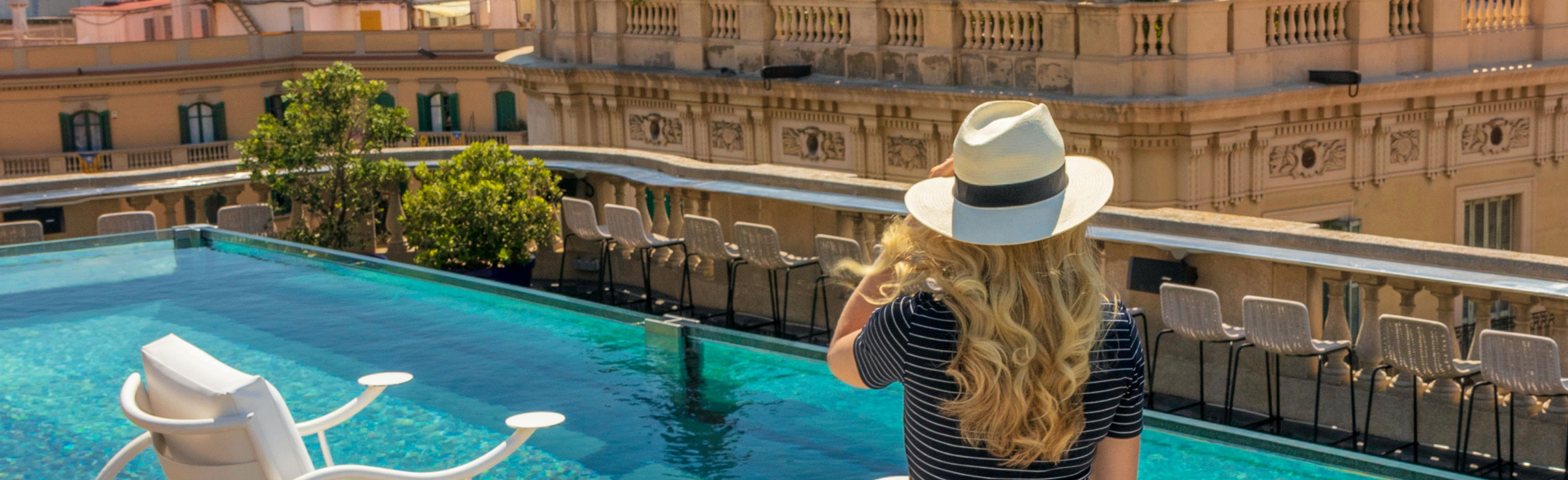 Barcelona hotel, woman by balcony pool