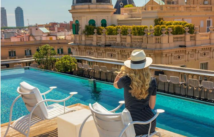 Barcelona hotel, woman by pool