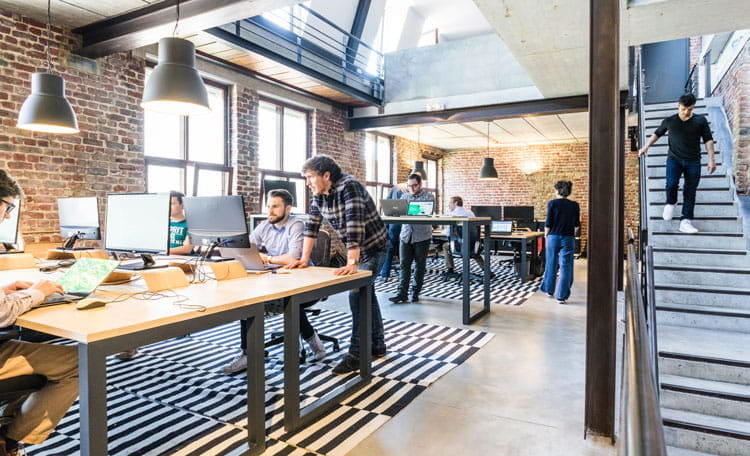 flexible workspace people working in converted warehouse