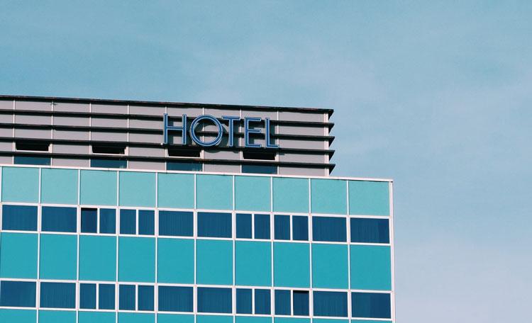 high rise hotel facade, modern blue building