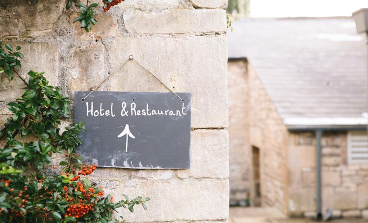 Sign saying 'Hotel & Restaurant' at The Pig - near Bath,Hunstrete, United Kingdom