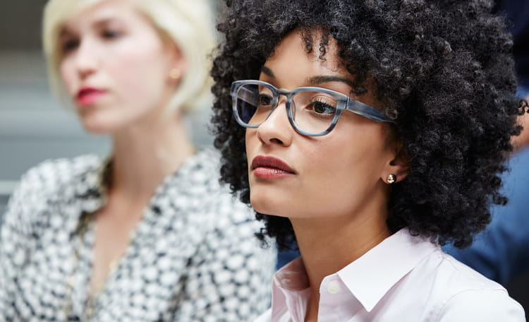 woman with glasses in workplace