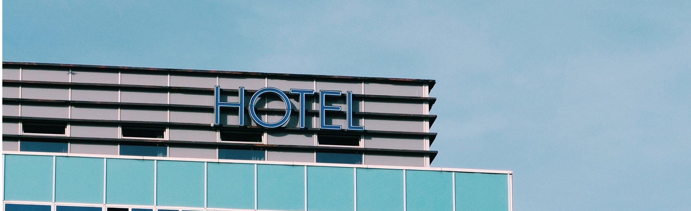 facade of the top of high rise hotel, modern blue